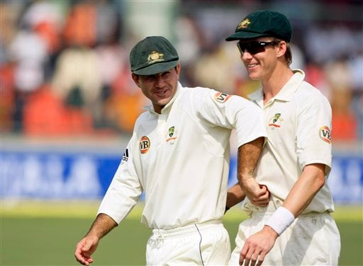 Brett Lee and captain Ricky Ponting share a lighter moment while returning for lunch during the first day of the third cricket Test match between India and Australia in New Delhi on Wednesday, October, 2008.