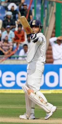 Sachin Tendulkar acknowledges the crowd after scoring half a century against Australia during the first day of their third cricket Test match in New Delhi on Wednesday, October, 2008.