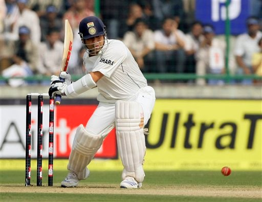 Sachin Tendulkar prepares to bat against Australia during the first day of their third cricket Test match in New Delhi on Wednesday, October, 2008.
