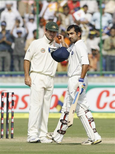 Gautam Gambhir reacts after scoring his double century as Ricky Ponting looks on during the second day of their third Test match in New Delhi.