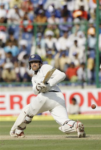 Anil Kumble hits a shot against Australia on the second day of their third Test in New Delhi.