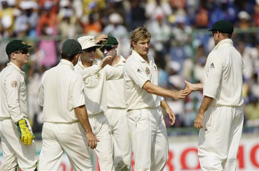 Shane Watson is congratulated by teammates after he took the wicket of Gautam Gambhir on the second day of their third Test in New Delhi.