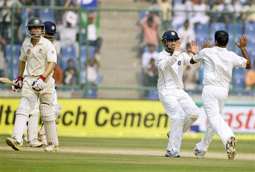 Gautam Gambhir and Amit Mishra celebrate the dismissal of Simon Katich on the third day of the third Test between India and Australia in New Delhi.