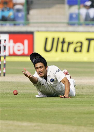 Anil Kumble fields a ball on the third day of the third Test between India and Australia in New Delhi.