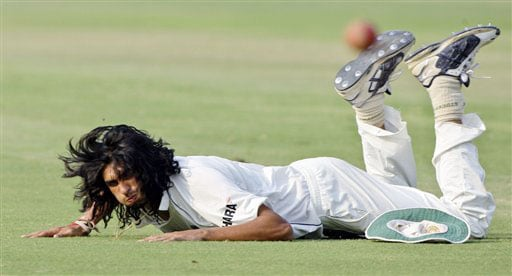 Ishant Sharma lies on the ground after a failed fielding attempt on the third day of the third Test match between India and Australia in New Delhi.