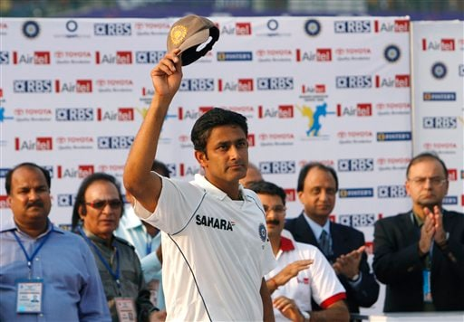 Indian cricket team captain Anil Kumble takes off his cap as the crowd cheers him for his contribution to cricket on the final day of the third Test cricket match between India and Australia in New Delhi on Sunday, Nov. 2, 2008. Kumble, the third most successful bowler in Test history with 619 wickets, announced his retirement at the end of the third Test against Australia.