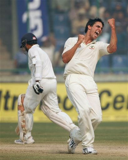 Mitchell Johnson celebrates after claiming the wicket of Gautam Gambhir, unseen, on the final day of the third Test cricket match between India and Australia on Sunday, Nov. 2, 2008.
