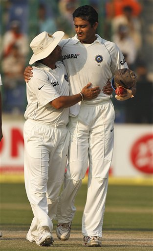 Anil Kumble is hugged by team mate Sachin Tendulkar on the final day of the third Test cricket match between India and Australia on Sunday, Nov. 2, 2008. Kumble, the third most successful bowler in Test history with 619 wickets, announced his retirement at the end of the third Test against Australia.