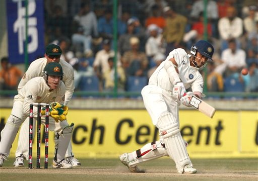 Sourav Ganguly hoists a ball for six, as Australian wicketkeeper Brad Haddin (centre) front, and his teammate Matthew Hayden look on, on the final day of the third Test cricket match between India and Australia in New Delhi on Sunday, Nov. 2, 2008.
