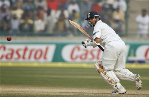 Sachin Tendulkar places a ball on the leg side on the final day of the third Test cricket match between India and Australia in New Delhi on Sunday, Nov. 2, 2008.