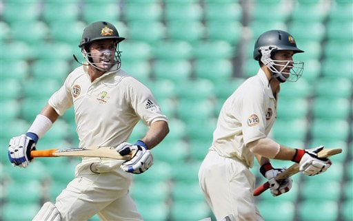 Mike Hussey and Simon Katich run between the wickets during the third day of the Nagpur Test. (AP Photo)