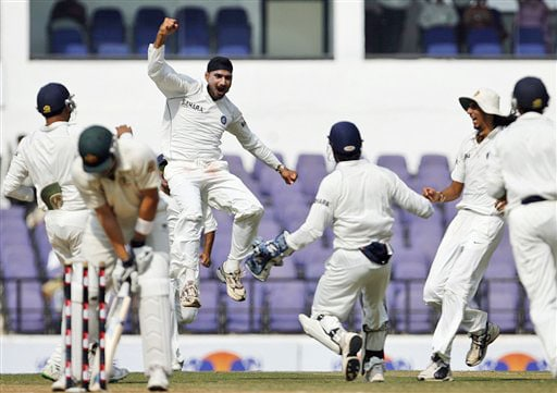 Harbhajan Singh celebrates after he dismissed Shane Watson as Indian players run in to congratulate him during the third day of the Nagpur Test. (AP Photo)