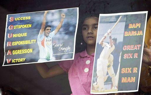 Sana Ganguly, the daughter of Sourav Ganguly, holds posters in praise of her dad after he was dismissed during the fourth day of the final Test between India and Australia in Nagpur.