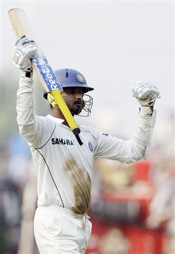 Harbhajan Singh gestures after he scored a half-century during the fourth day of the final Test between India and Australia in Nagpur.