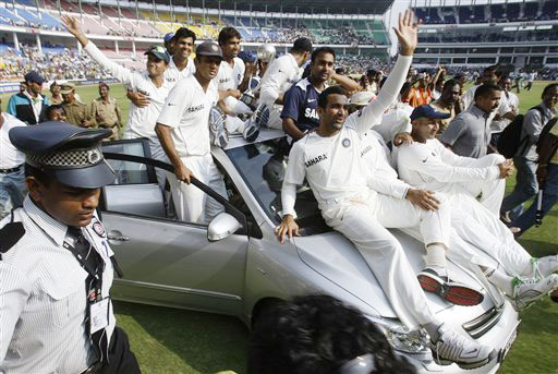 Indian team ride around the stadium on a car presented to Ishant Sharma as an award for Man of the Series after India beat Australia in the final Test in Nagpur.