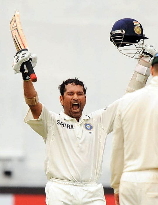 Sachin Tendulkar roars in celebration after India won the second Test match between India and Australia in Bangalore. (AFP Photo)
