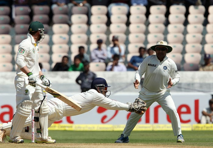 Phil Hughes looked steady but was not confident against spin. Ashwin finally managed to get one to turn and bounce sharply. Dhoni held on to a good catch in the second attempt. (Photo credit: BCCI)