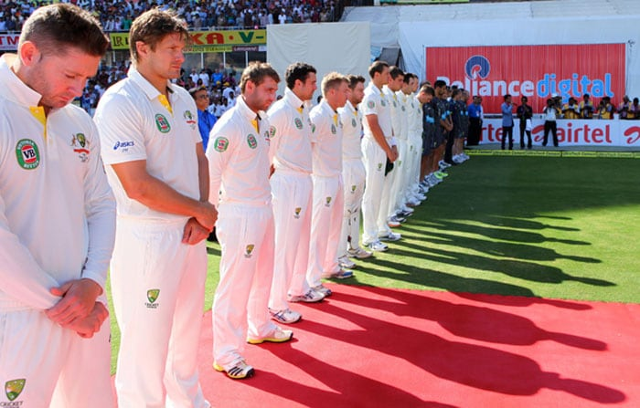 Michael Clarke, skipper of Australia and team mates line up for a minute's silence to honour those killed and injured in the explosions last week in Hyderabad during day 2 of the 2nd Airtel Test match between India and Australia held at the The Rajiv Gandhi International Stadium. (Photo credit: BCCI)