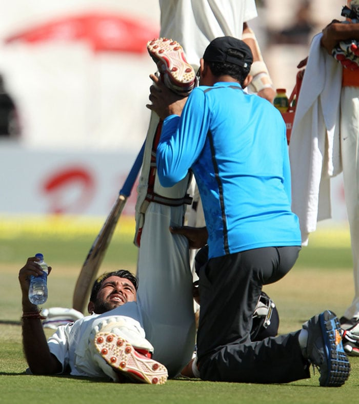 Cheteshwar Pujara survived an injury scare as he ran a 'risky' run and David Warner leapt to run him out. The India No.3 possibly landed heavily on his knee and looked in discomfort thereafter. He survived another close run-out appeal before lunch. (Photo credit: BCCI)