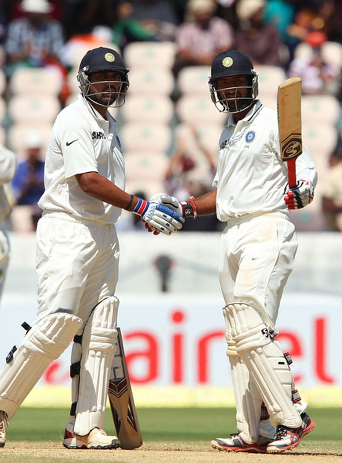 Opener Murali Vijay and number three batsman Cheteshwar Pujara batted with a lot of purpose as India took major strides toward winning the second Test against Australia in Hyderabad. The pair got together at 17/1 with Sehwag's wicket and were not-out on 129 and 162 respectively at stumps on Day 2. India scored 311/1 with a lead of 74 runs. (Photo credit: BCCI)