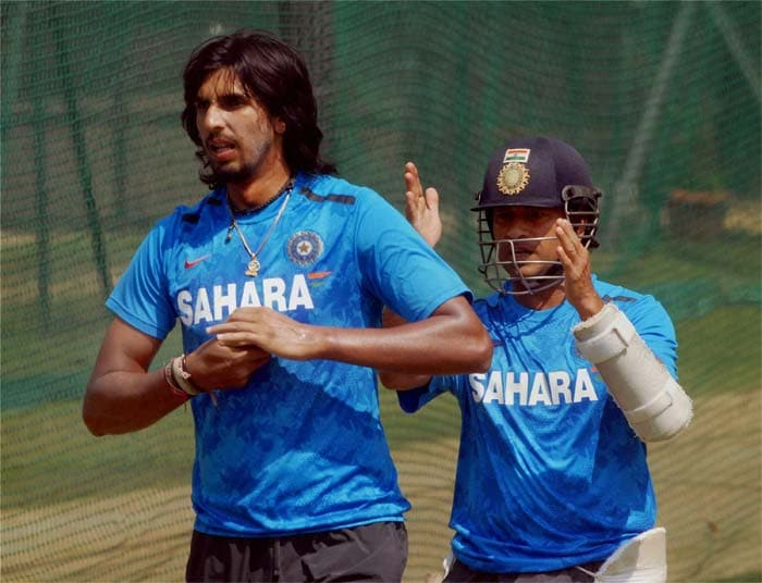 A morale-boosting win clinched in the opening Test, a confident India will look to consolidate their position by putting up another dominant performance in the second cricket Test against Australia starting on Saturday. <br> <br> Sachin is seen guiding a battling Ishant Sharma here, who has tried hard but does not have the results to show for. (Photo and text credit: PTI)