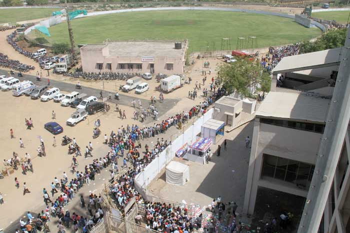 Spectators queue outside the stadium before the start of the World Cup quarter final match between India and Australia at The Sardar Patel Stadium, Motera in Ahmedabad. (AFP Photo)