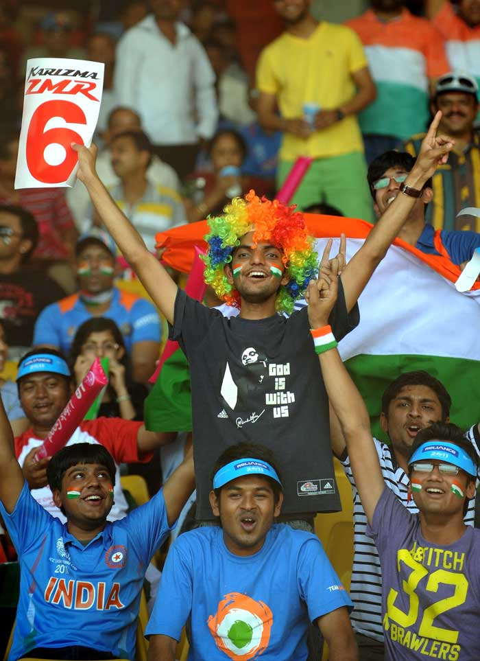 Indian cricket fans cheer prior to the India and Australia World Cup quarterfinal match. (AFP Photo)
