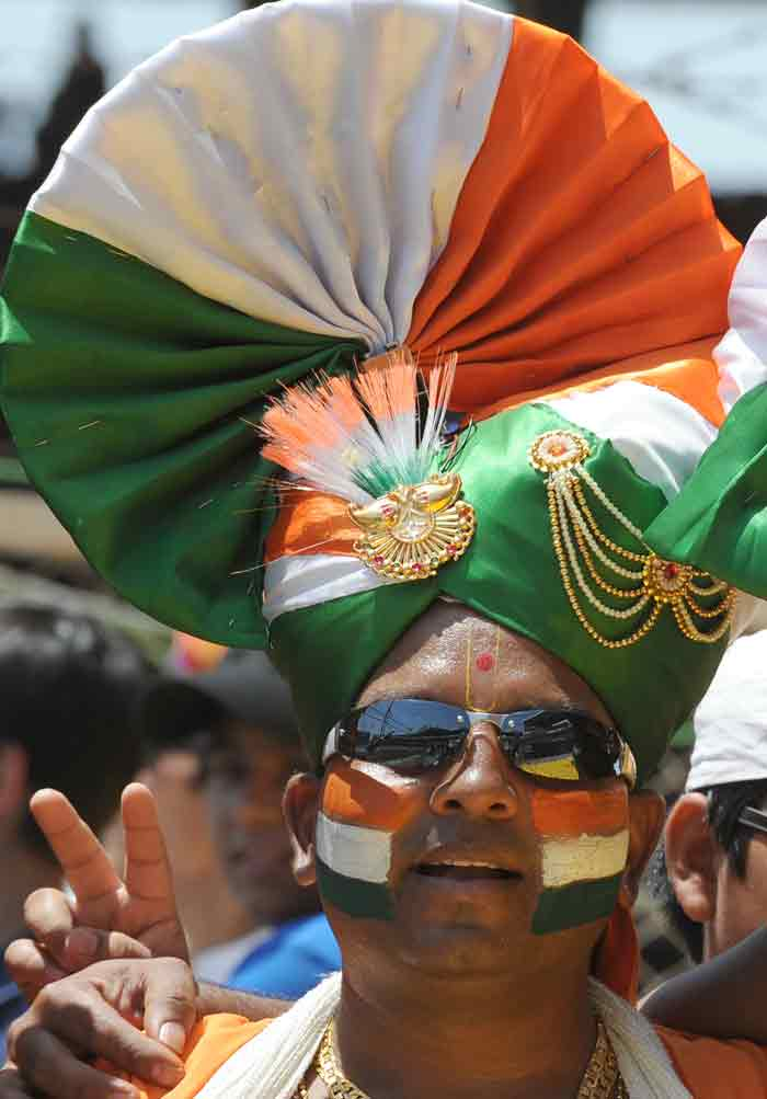 An Indian cricket fan wearing a turban in the national colours cheers prior to the India and Australia World Cup quarter final match. (AFP Photo)