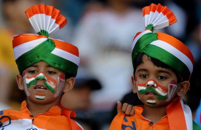 Two young Indian cricket fans wearing turbans in the national colours cheer prior to the India and Australia World Cup match. (AFP Photo)