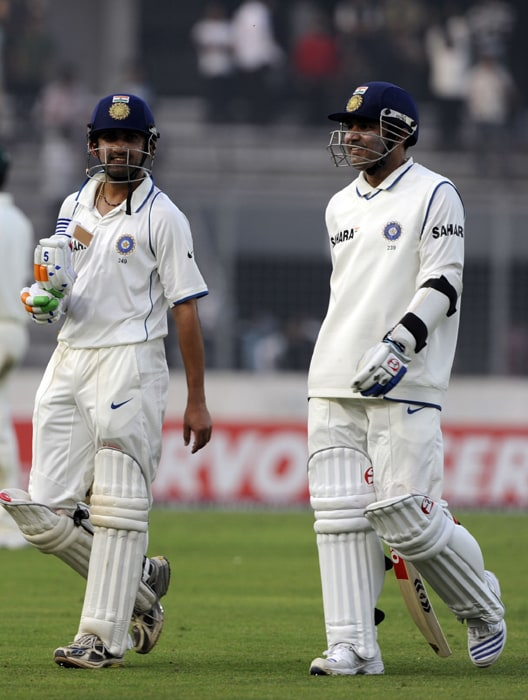 Gautam Gambhir and his teammate Virender Sehwag leave the ground after the first day of the second Test at The Sher-e Bangla National Stadium in Dhaka. India were 69 for no loss in their first innings at stumps in reply to Bangladesh's 233. (AFP Photo)