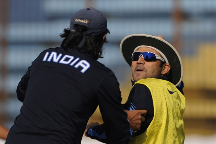 Indian cricketer Virender Sehwag (R) shares a light moment with teammate Ishant Sharma (L) during a practice session at Zohur Ahmed Chowdhury Stadium in Chittagong on January 15, 2010. India will play two Test series against Bangladesh. (AFP PHOTO)