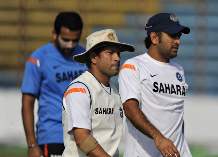 Mahendra Singh Dhoni (R) and his teammates Sachin Tendulkar (C) and Zaheer Khan (L) leave the field after a practice session at Zohur Ahmed Chowdhury Stadium in Chittagong. Dhoni has been ruled out of the first Test due to a back spasm. (AFP PHOTO)