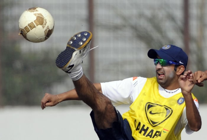 Indian opener Gautam Gambhir kicks a football during a practice session prior to the first Test match against Bangladesh in Chittagong. (AFP PHOTO)