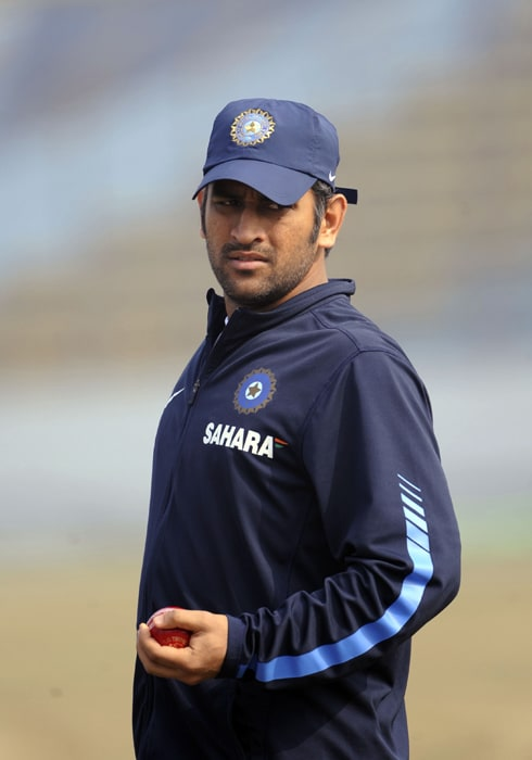 In a major setback to the Indian team, captain Mahendra Singh Dhoni has been ruled out of the first Test against Bangladesh in Chittagong due to a back spasm. Here, he is seen taking part in the training session at Zohur Ahmed Chowdhury Stadium in Chittagong. (AFP PHOTO)