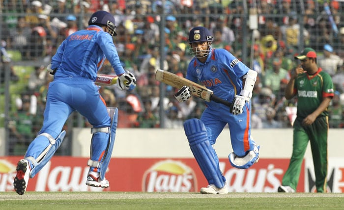 Indian opening batsmen Sachin Tendulkar and Virender Sehwag run between the wickets during the opening match of the ICC Cricket World Cup against Bangladesh at the Sher-E-Bangla National Stadium in Dhaka. (AP Photo)