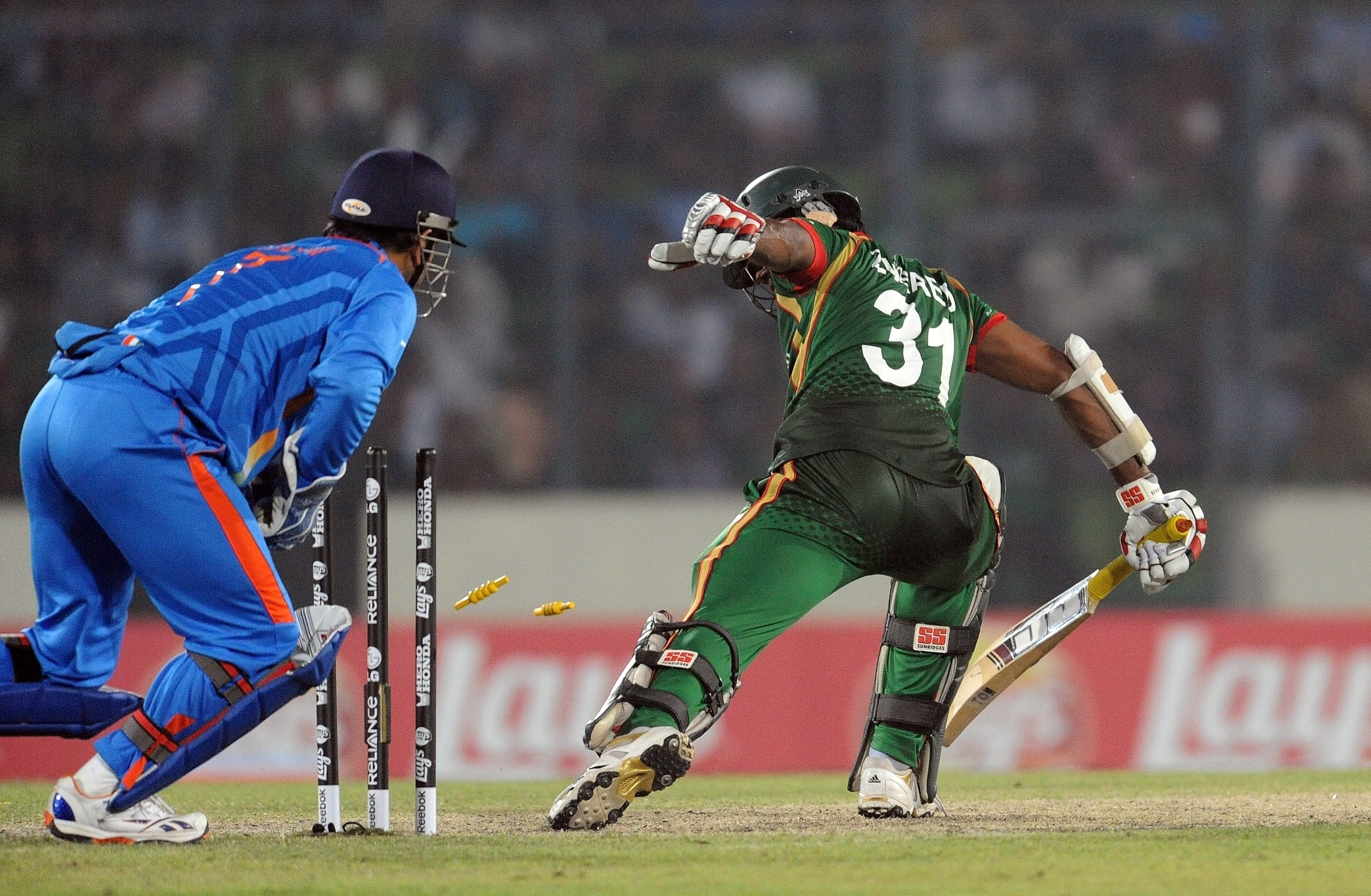 MS Dhoni successfully stumps out Junaid Siddique off the bowling of Harbhajan Singh during the first match in the World Cup tournament between Bangladesh and India at the Sher-e Bangla National Stadium in Dhaka. (AFP Photo)