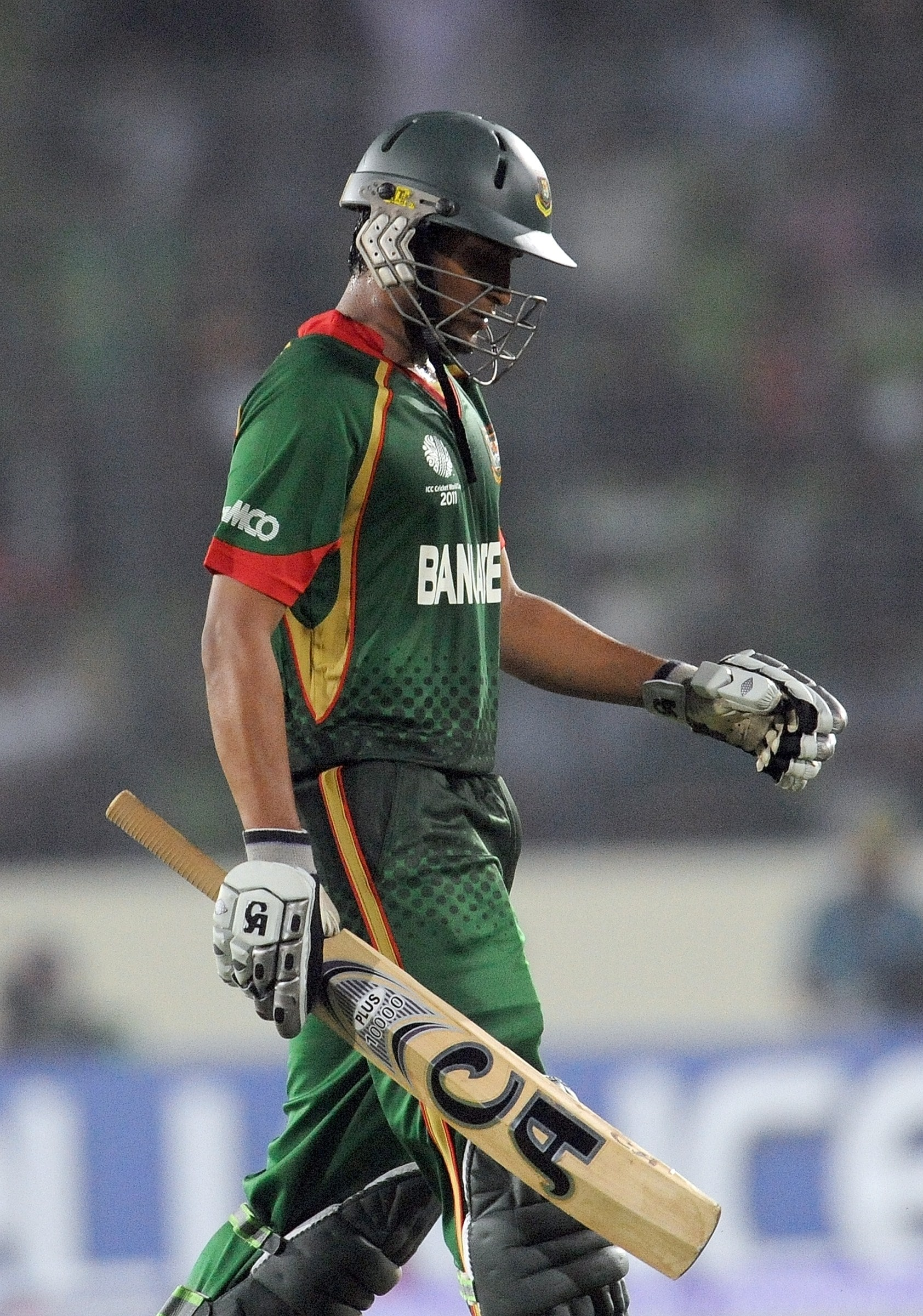Shakib Al Hasan walks back to the pavillion after his dismissal during the first match in the World Cup tournament between Bangladesh and India at the Sher-e Bangla National Stadium in Dhaka. (AFP Photo)