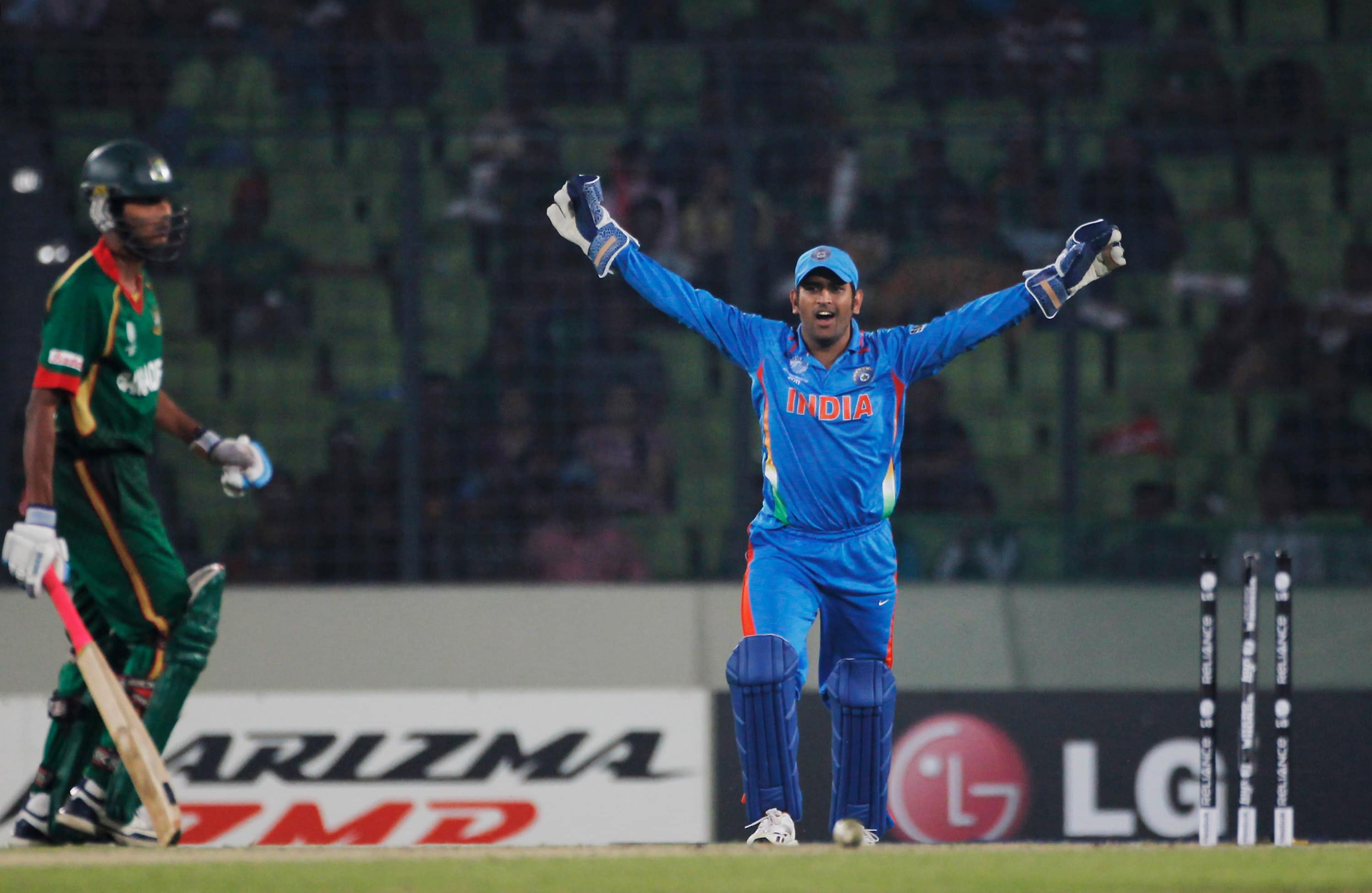 MS Dhoni celebrates the run out of Shafiul Islam of Bangladesh during the opening game of the ICC World Cup between Bangladesh and India at the Sher-e-Bangla National Stadium in Dhaka. (Getty Images)
