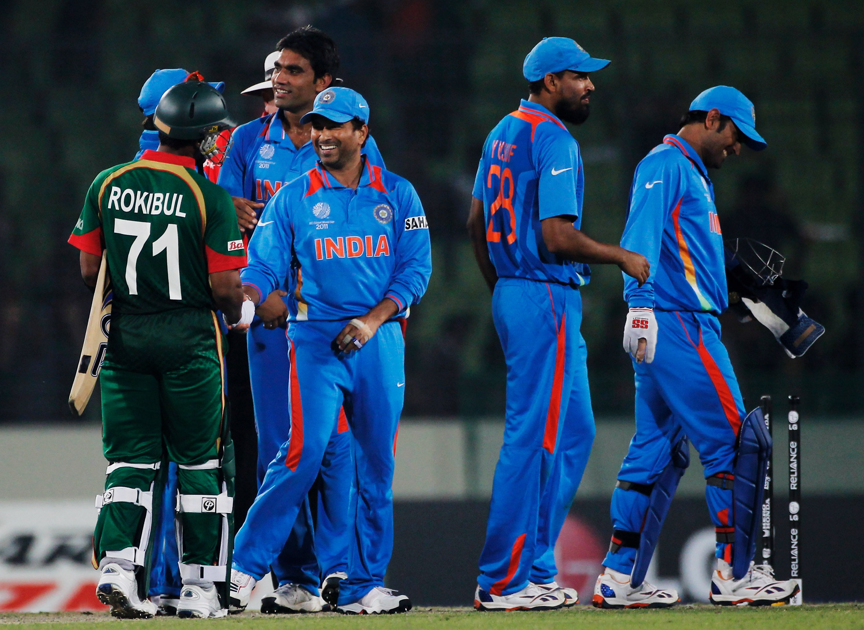 The Indian team celebrate victory over Bangladesh after winning by 87 runs during the opening game of the ICC World Cup at the Sher-e-Bangla National Stadium in Dhaka. (Getty Images)
