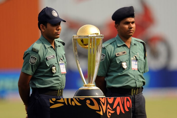 Security personnel guard the Cricket World Cup trophy prior to the tournament's first match between India and Bangladesh at the Sher-e-Bangla National Stadium in Dhaka. (AFP Photo)