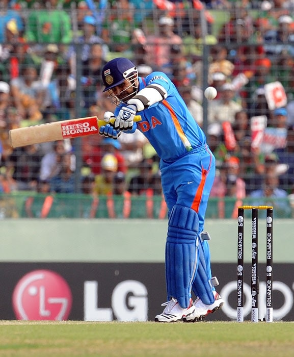 Virender Sehwag plays a shot during the first match in the ICC World Cup tournament between Bangladesh and India at the Sher-e Bangla National Stadium in Dhaka. (AFP Photo)