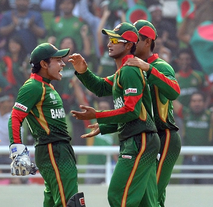 Everything seemed to be going India's way until calamity struck. A good piece of fielding from Bangladesh Shakib Al Hasan meant that Sehwag and Sachin were stranded at the same end. <br><br> As a result Sachin was run out and Bangladesh enjoyed their first success in the World Cup. (AFP Photo)