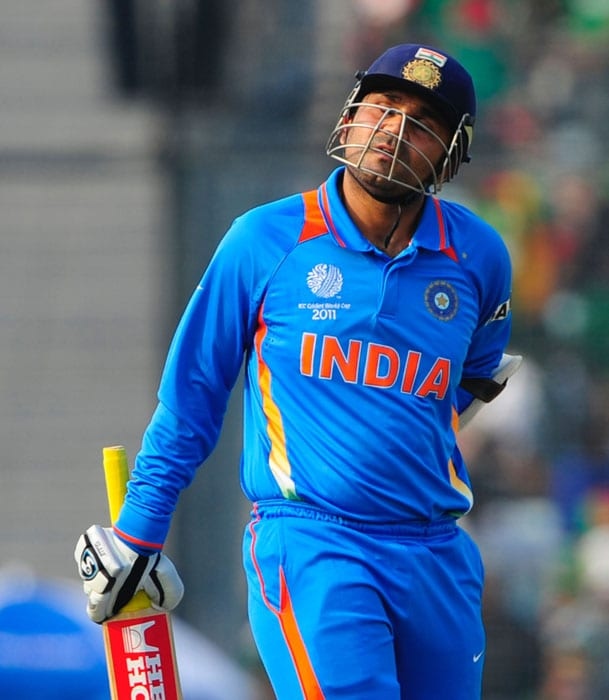 After his hundred, Sehwag was seen ambling while running between the wickets. Soon his discomfort had to be addressed and Gautam Gambhir had to be brought in as a substitute runner. (AFP Photo)