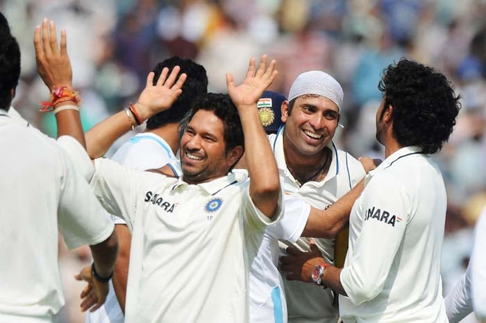 Indian cricketers congratulate VVS Laxman as they celebrate India's win over Australia during the final day of the first Test between India and Australia in Mohali. (AFP Photo)