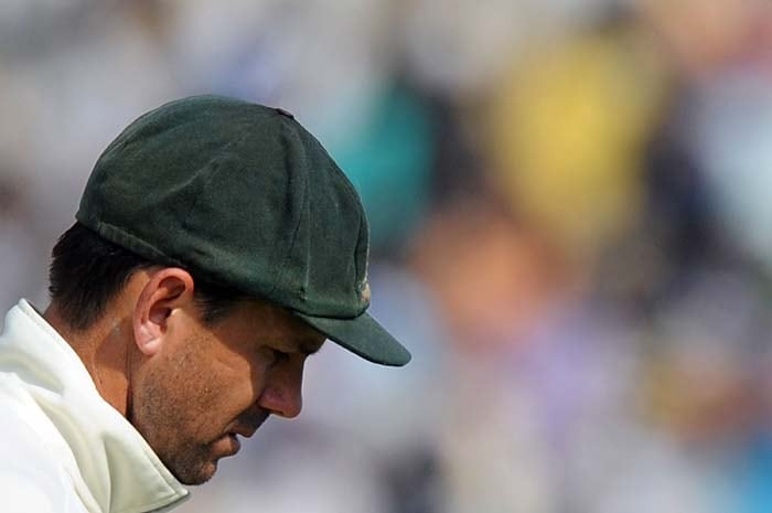 Australian cricket captain Ricky Ponting reacts as he walks back to the dressing room during the final day of the first Test between India and Australia in Mohali. (AFP Photo)