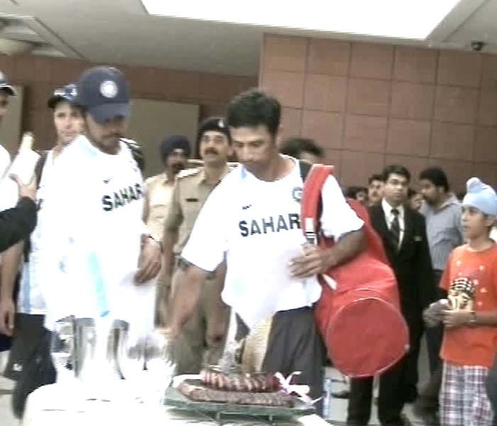 Indian batsman Rahul Dravid is seen cutting the cake at the team hotel.