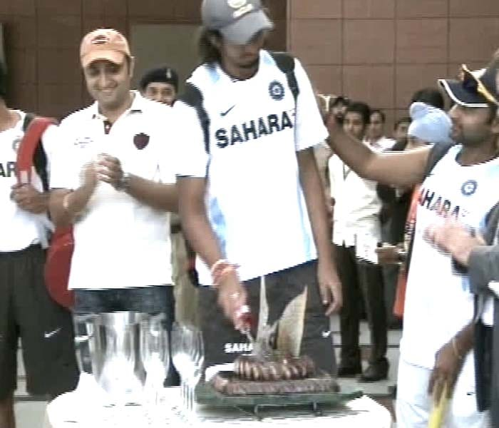 Indian pacer Ishant Sharma cuts the cake. Ishant played a crucial role in the victory as he was part of a 81-run partnership with VVS Laxman which took the team home.