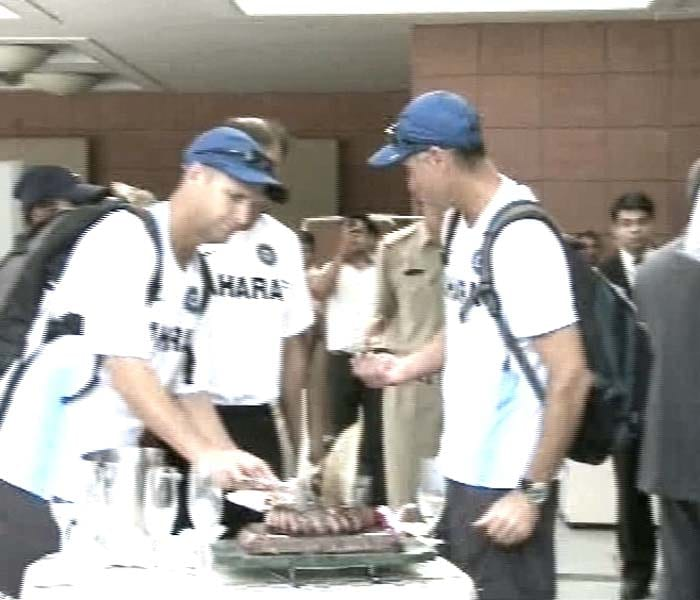 Indian coach Gary Kirsten cuts the cake during the celebrations.