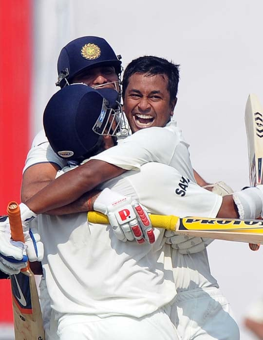 Indian cricketer V.V.S Laxman with Pragyan Ojha and Suresh Raina celebrate India's win over Australia during the final day of the first Test between India and Australia in Mohali. (AFP Photo)
