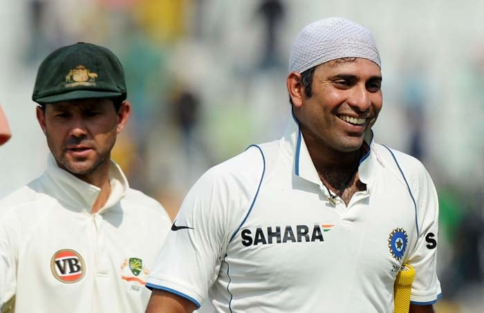 India's VVS Laxman celebrates the team's victory as Australian captain Ricky Ponting looks on during the final day of the first Test between India and Australia in Mohali. (AFP Photo)